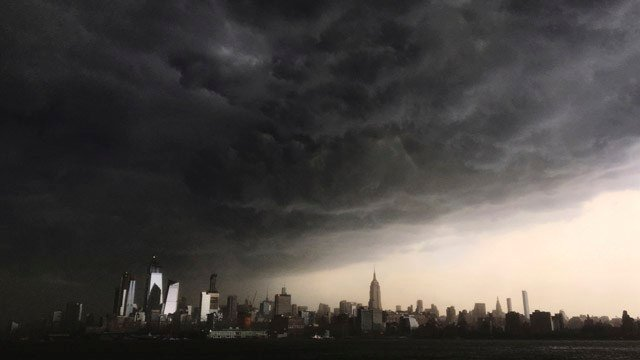 In this Tuesday, May 15, 2018 photo, storm clouds gather over New York city seen from the Hudson River. A line of strong storms pushed across New York City and badly disrupted the evening commute, stranding thousands of train riders. (AP Photo)