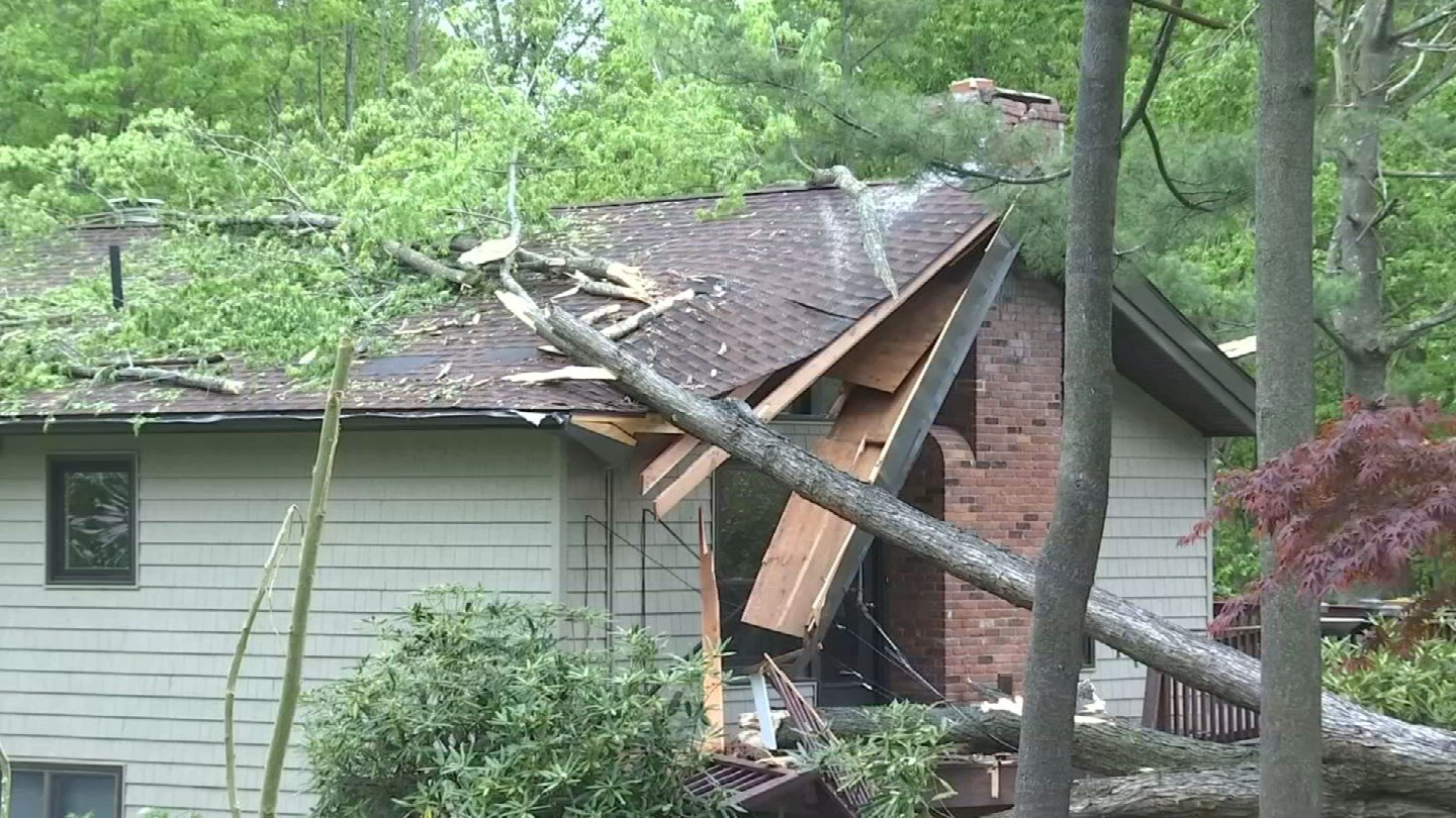 Homeowners in Hamden continued to assess tornado damage on Thursday. (WFSB)