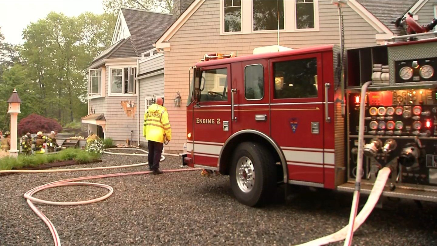 Lightning struck a tree near a house on Talcott Farm Road and it sparked a fire early Wednesday morning. (WFSB)