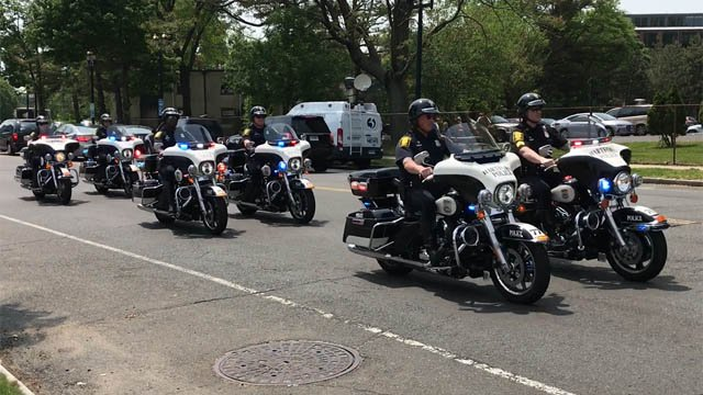 Officers lined up at Hartford Hospital to escort Officer Jill Kidik, who was released after being stabbed in the neck last week. (WFSB)