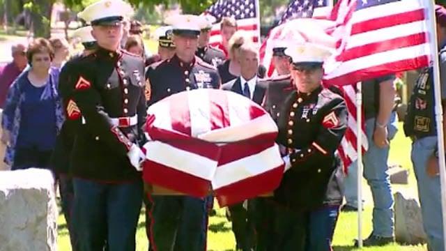 Marine Sgt. Elden Grimm was buried in Wisconsin on Saturday, 75 years after his death. (WLUK/CNN)