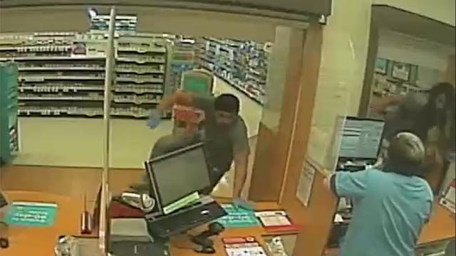 Two of the suspects jumped over the pharmacy counter to steal pills (Meriden Police)