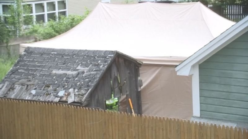 The investigation shifted from the home to the garage and yard on Thursday. (WFSB)