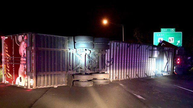 A truck carrying mushrooms rolled over early Thursday on I-84 east in Southbury. (State police)