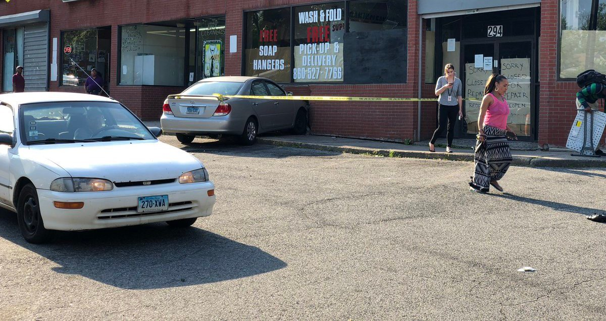 A car crashed into a a laundromat in Hartford (WFSB)