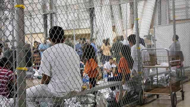 In this photo provided by U.S. Customs and Border Protection, people who've been taken into custody related to cases of illegal entry into the U.S., sit in one of the cages at a facility in McAllen, Texas, Sunday (U.S. Customs and Border Protection's Rio