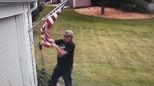Man caught on camera stealing mayor's flag