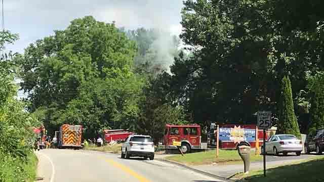 Crews are working to extinguish a house fire in Norwich (WFSB)