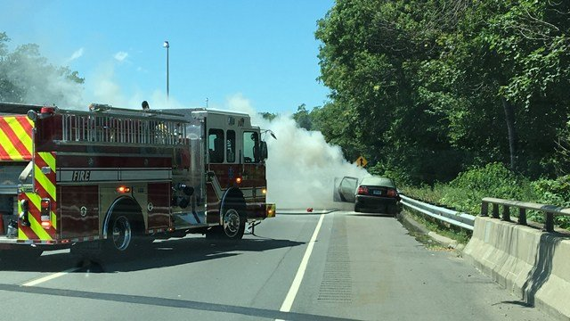 A woman was saved after her car crash and caught on fire on I-95 (Fairfield FD)