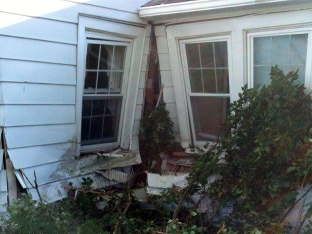 A car slammed into a home in Morris on Friday morning.