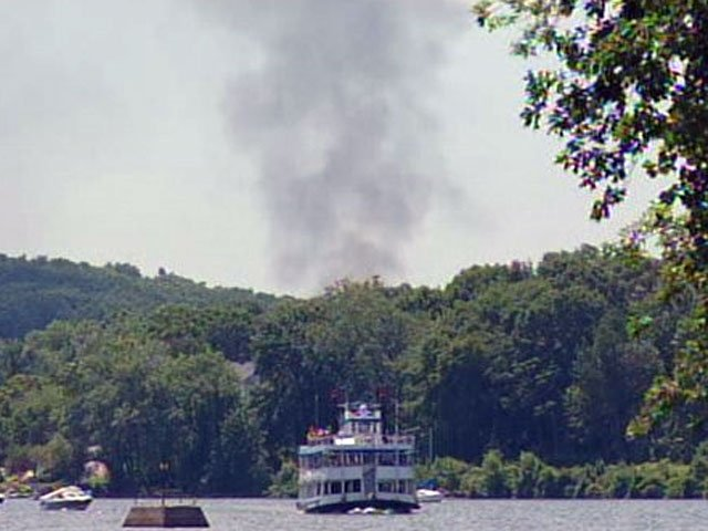 Smoke from a fire in Essex rises above the Connecticut River