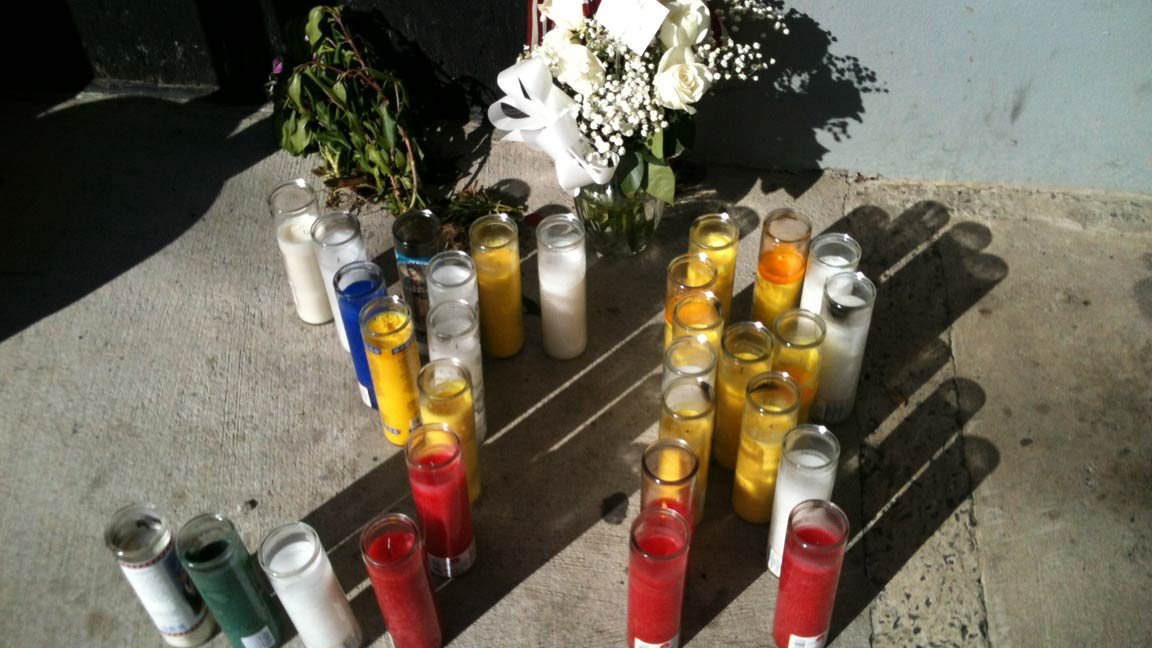 © Memorial has been set up outside the store Ramon Perez and Esmerito Perez Mendez owned in Hartford.
