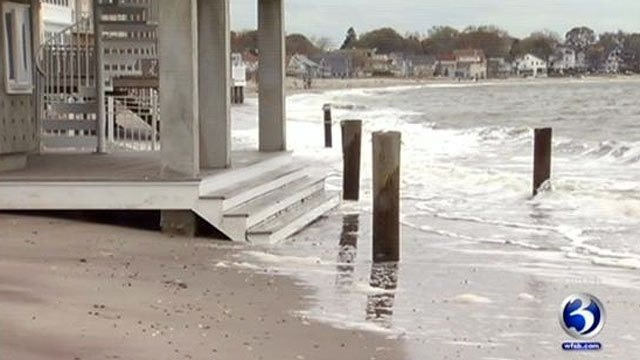 Water inches closer to a home along the shore as Hurricane Sandy inches closer to Connecticut