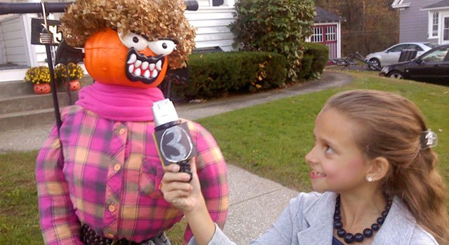 © Emma Braithwate, 9, interviews a pumpkin scarecrow in her WFSB anchor costume.
