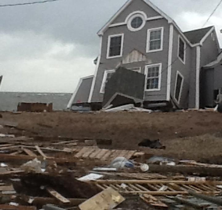 © A home damaged on Cosey Beach in East Haven.
