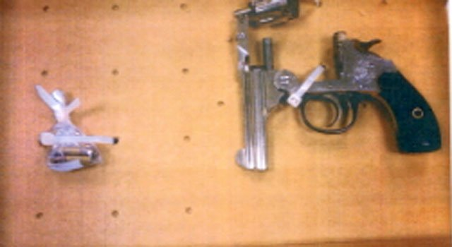 © A 22.Caliber Revolver and ammunition, which was one of the weapons recovered by police.