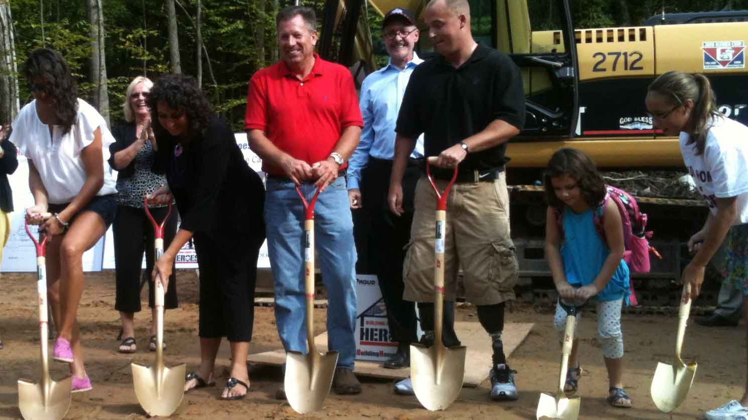© A photo from the groundbreaking ceremony for Sgt. Greg Caron