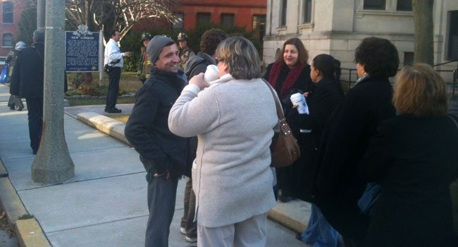 © City employees waited outside while firefighters investigated an odor at New London City Hall Thursday.