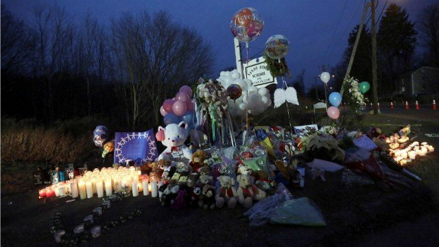 Candles, balloons, stuffed animals and personal notes are placed on a memorial for the victims (AP Photo/Mary Altaffer)