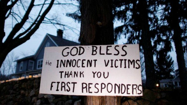 A message of thanks and prayer is displayed outside a home (AP Photo/Jason DeCrow)
