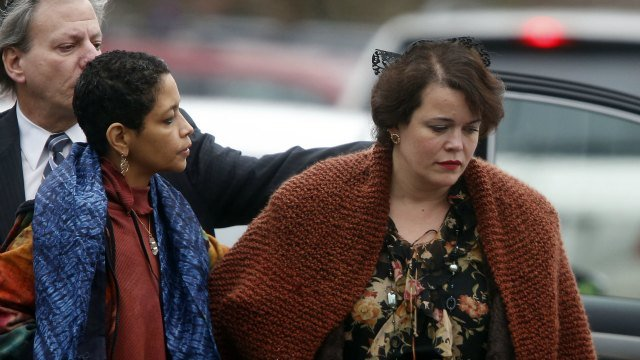 Veronika Pozner, right, arrives at a funeral service for her son, 6-year-old Noah Pozner, Monday, Dec. 17, 2012, in Fairfield, Conn. Pozner was killed when Adam Lanza walked into Sandy Hook Elementary School in Newtown Friday and opened fire, killing 26 p