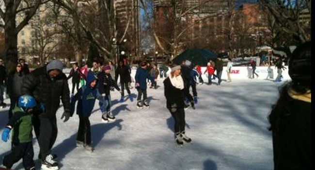 © People ice skate Friday afternoon at Bushnell Park in Hartford.