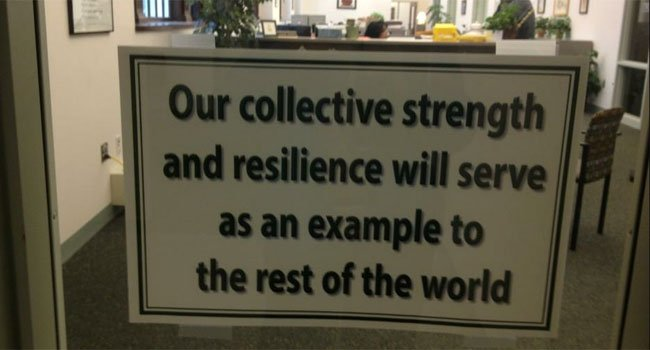 © The message outside the Board of Education office in Newtown.