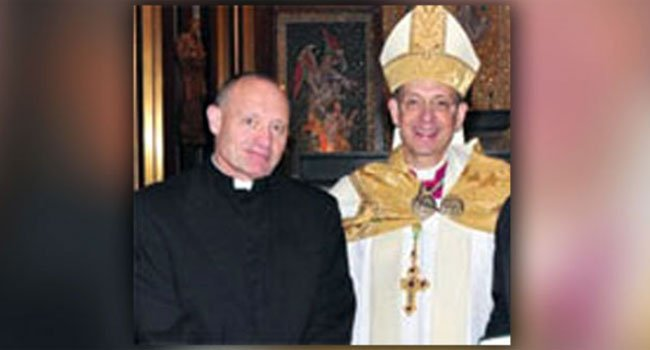© Monsignor Kevin Wallin, who is seen here on the left next to former Bridgeport Bishop William Lori, was arrested by federal agents at his Waterbury home earlier this month.