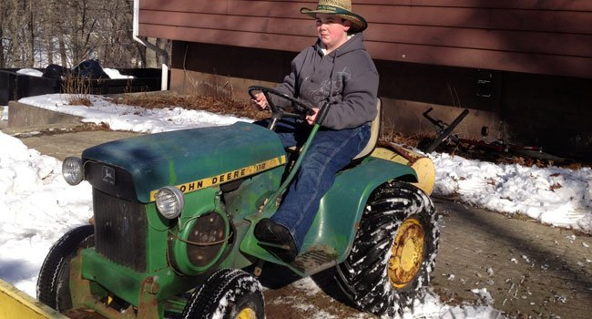  Avery Johnson of Chester prepares his tractor fit for the snow.
