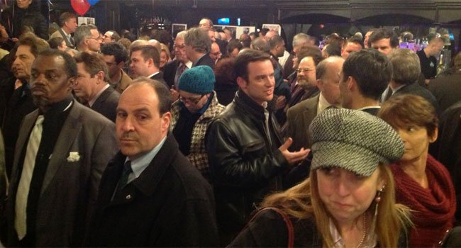 © The crowd waits for the announcement by New Haven Mayor John DeStefano.
