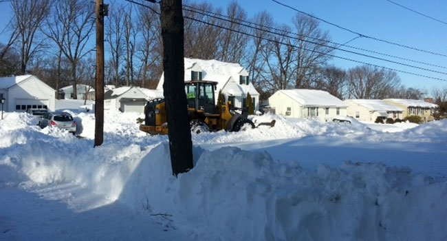 © Plow comes down a street in New Britain.