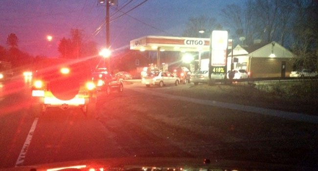 © A line formed at the Citgo gas station on Main Street in Cromwell Thursday evening.