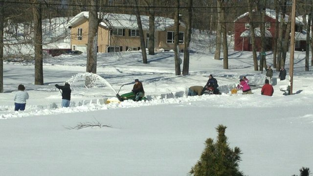© Neighbors used shovels, snowblowers and tractors to clear the streets in Meriden.