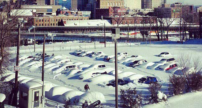  Cars buried under snow in downtown Hartford.
