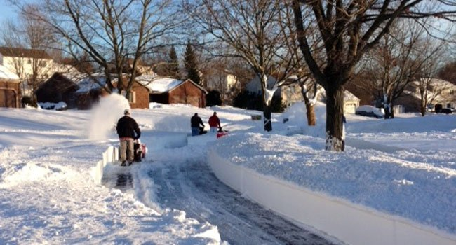 © Neighbors helping neighbors on Evergreen Lane in Meriden.
