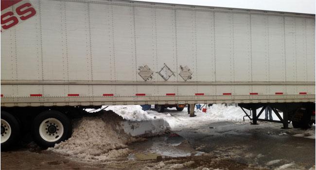 © Semi-trailer truck stuck in snow in Waterbury.