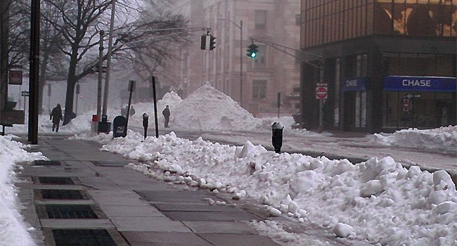  Mounds of snow remain on Church Street New Haven.