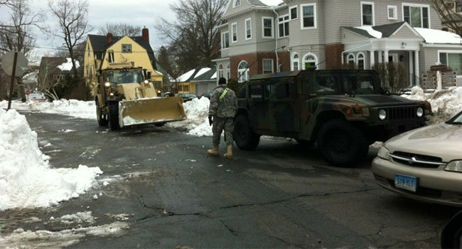 © Members of the Connecticut National Guard were clearing snow on Prospect Street in Hartford.