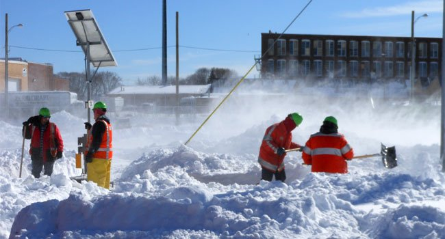 © Workers clearing tracks at Bridgeport Yard.