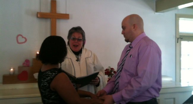 © Carlos and Dianne Hernandez get married at the Meeting House at Olde Mystic Village.