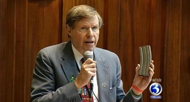 ? State Sen. Ed Meyer holds up a 30-round ammunition magazine.