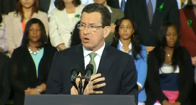 ? Gov. Dannel P. Malloy addresses the crowd at the University of Hartford Monday evening