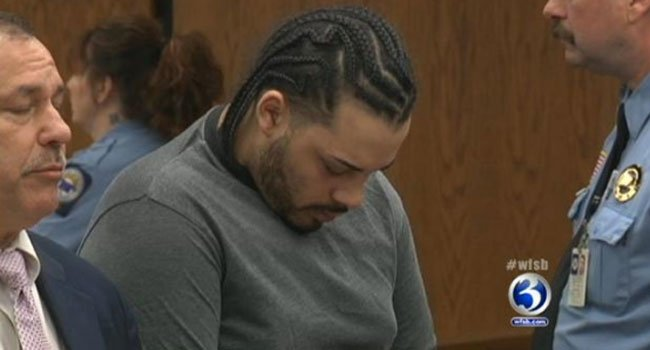 ? Mario Rivera puts his head down during his arraignment.
