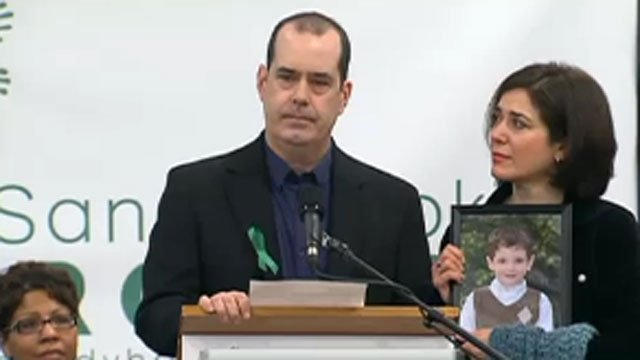 ? David Wheeler speaks and Francine Wheeler holds a picture of their son Ben during the launch of the Sandy Hook Promise event.