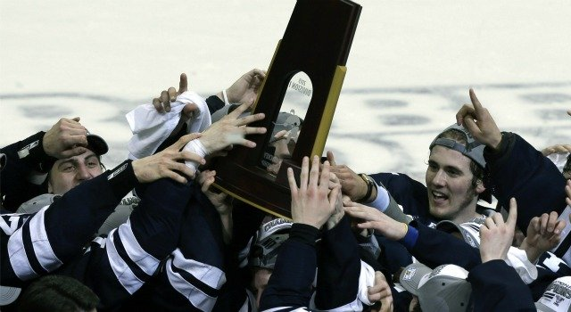 ? Members of the Yale men's hockey team hoist the trophy after winning the NCAA men's college hockey national championship game over Quinnipiac 4-0 in Pittsburgh, Saturday, April 13, 2013. (AP Photo/Gene Puskar)