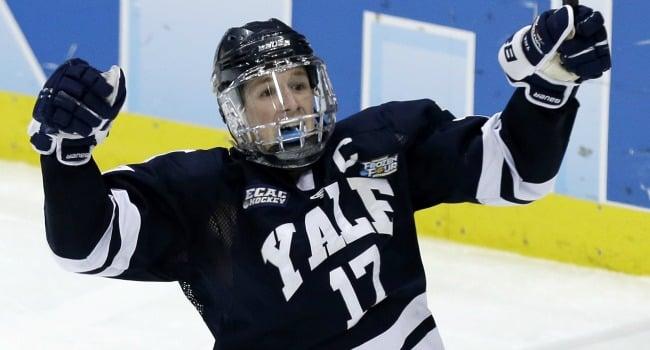 ? Yale's Andrew Miller (17) celebrates his break away goal in the third period of the NCAA men's college hockey national championship game in Pittsburgh Saturday, April 13, 2013. Yale beat Quinnipiac 4-0. (AP Photo/Gene J. Puskar)