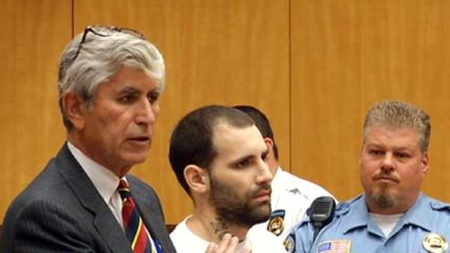 Sebastian Award, center, appeared in court Monday after being charged with attempted murder and robbery.