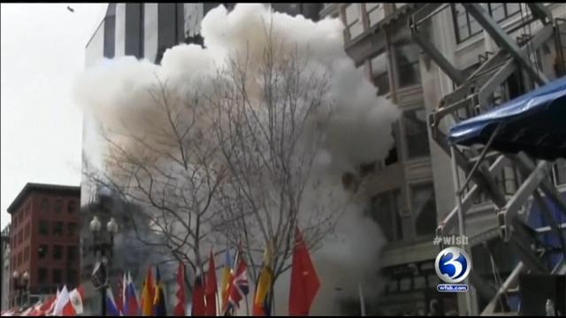 A bomb explodes at the Boston Marathon