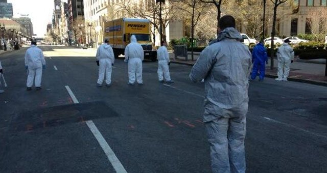 Officials line Boylston Street in Boston sweeping for evidence