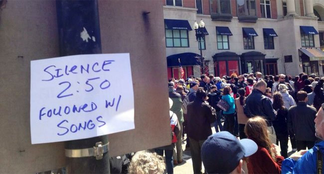 Huge crowd gathered near where bombs went off last week in Boston for a moment of silence on Monday afternoon.